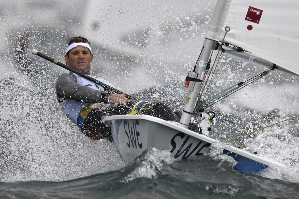 Sweden's Jesper Stalheim competes in the Laser Men sailing class on Marina da Gloria in Rio de Janerio during the Rio 2016 Olympic Games on August 10, 2016. / AFP PHOTO / WILLIAM WEST